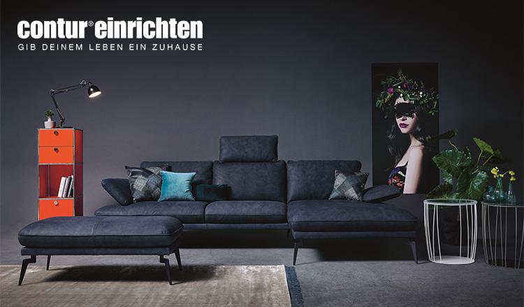 Dunkelblaues, sehr elegantes Sofa von contur einrichten