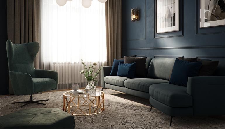 Elegantes Wohnzimmer mit dunkelblauem Sofa, grünem Drehsessel und Hocker im Farbton Petrol