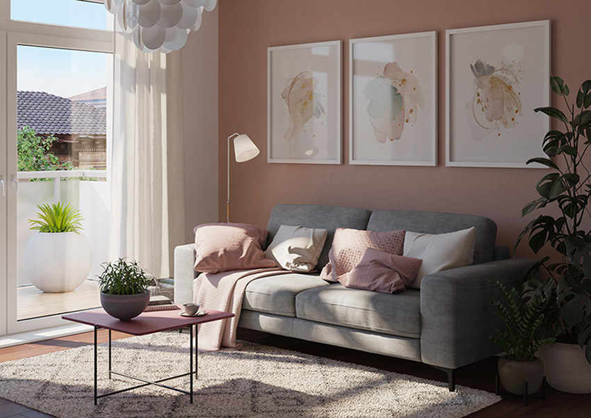 Graues 2-Sitzer Sofa vor einem Couchtisch im Beeren-Farbton