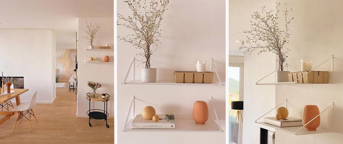 Verschiedene Ansichten zweier weißer Wandboards im Essbereich eines modern eingerichteten Zuhauses