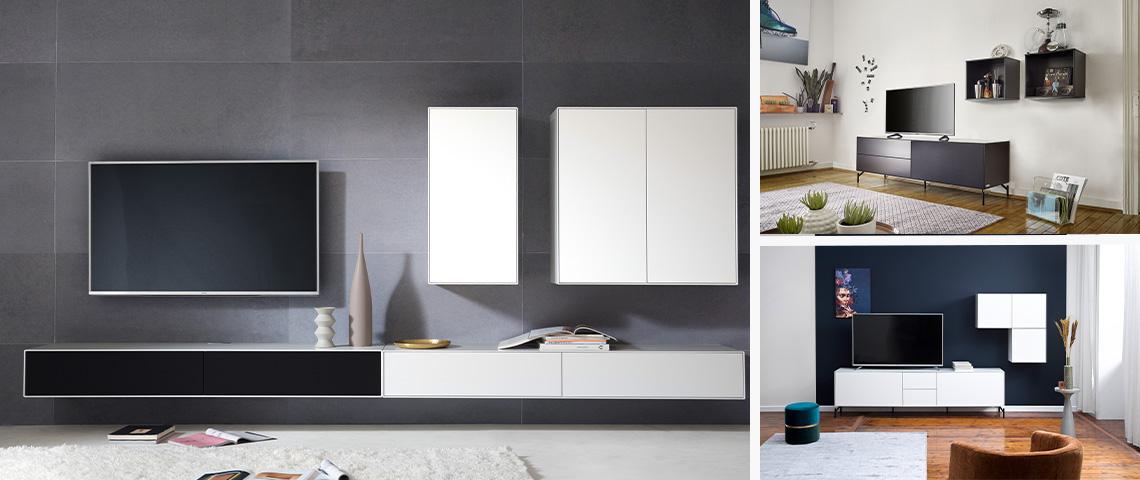 Minimalistische Wohnwand mit Hängelowboard und zwei Hängeschränken sowie einem schwarzem Sideboard mit Rollen