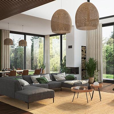 Dunkelgraue Wohnlandschaft im modern eingerichteten Wohnzimmer mit großen Fenstern