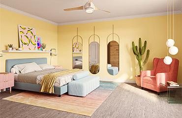 Bunt eingerichtetes Schlafzimmer mit Boxspringbett und rosa Sessel
