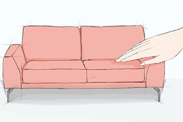 Rosafarbenes Sofa, das von einer großen Hand angefasst wird