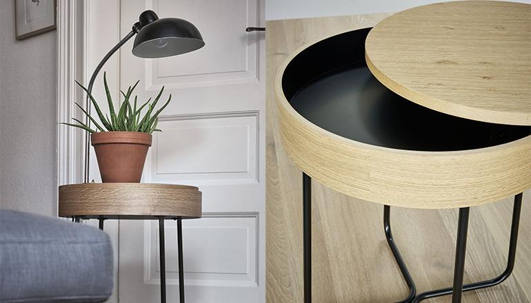 Beistelltisch mit runder Platte und Geheimfach dekoriert mit einer Pflanze