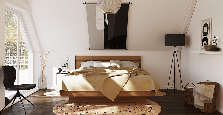 Aufgeräumtes Schlafzimmer mit Bettgestell aus Holz, dunklem Holzboden, Stuhl in Anthrazit