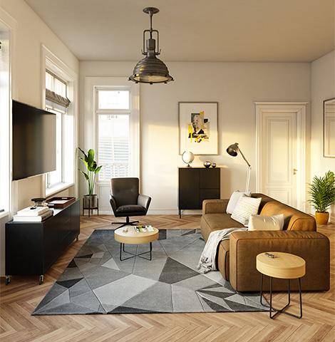 Loft mit olvigrünem Sofa, schwarzen Möbeln und einem weiß-grau-schwarzen Teppich