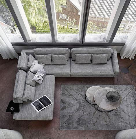 Schwarz-graues Ecksofa im minimalistischen Wohnzimmer